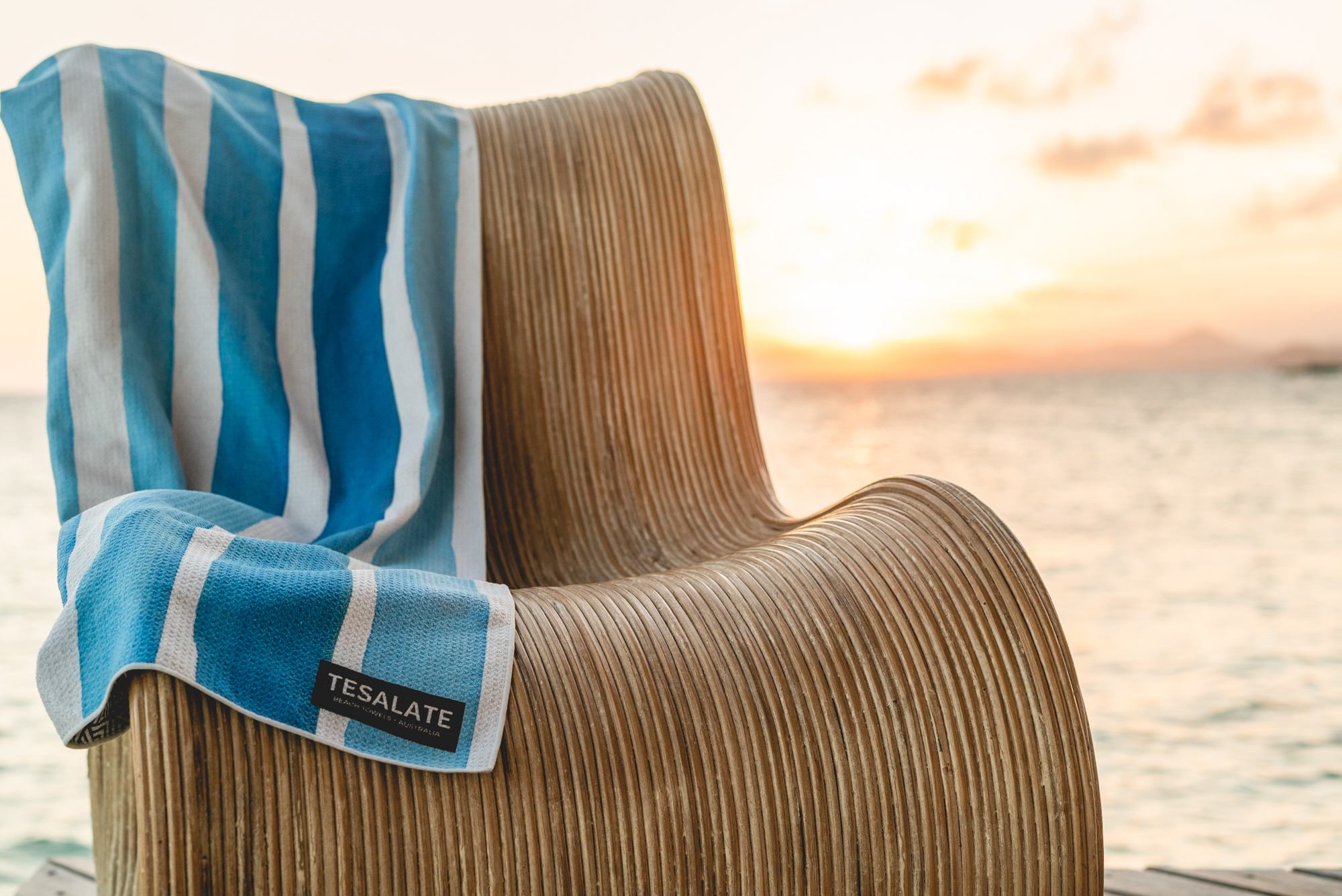 Tesalate Towel on a chair near the sea
