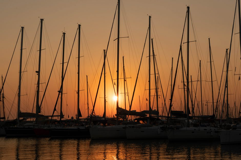 Sailboats with sunset behind them in Athens, Greece