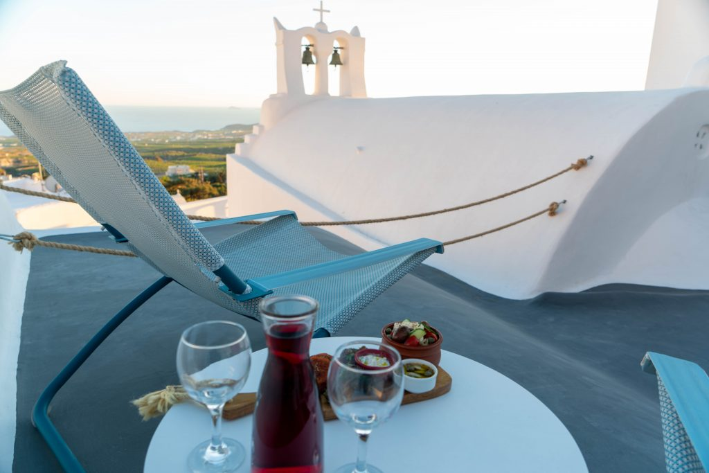 Greek mezes and wine on the roof deck of Demeter Cave House